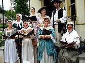 Colonial Revelers perform on Bastille Day.